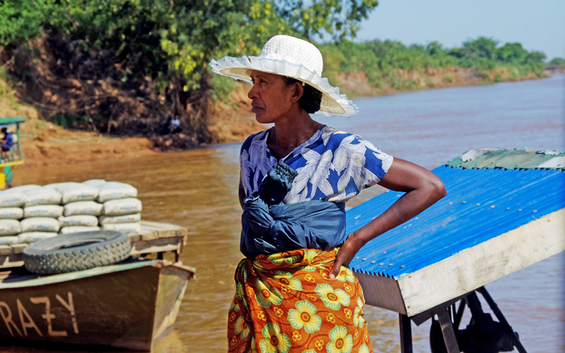 lady on river crossing