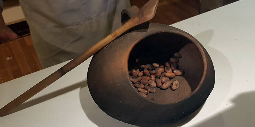 Crushing cocoa beans at Peruvian chocolate workshop