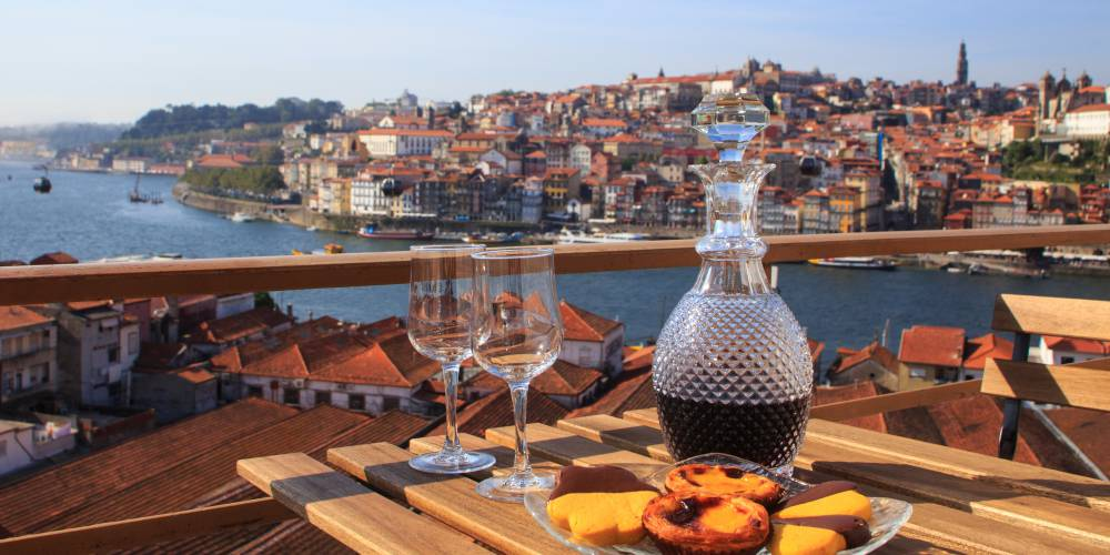 Wine and natas, Table with view a view over the river in Porto, Portugal
