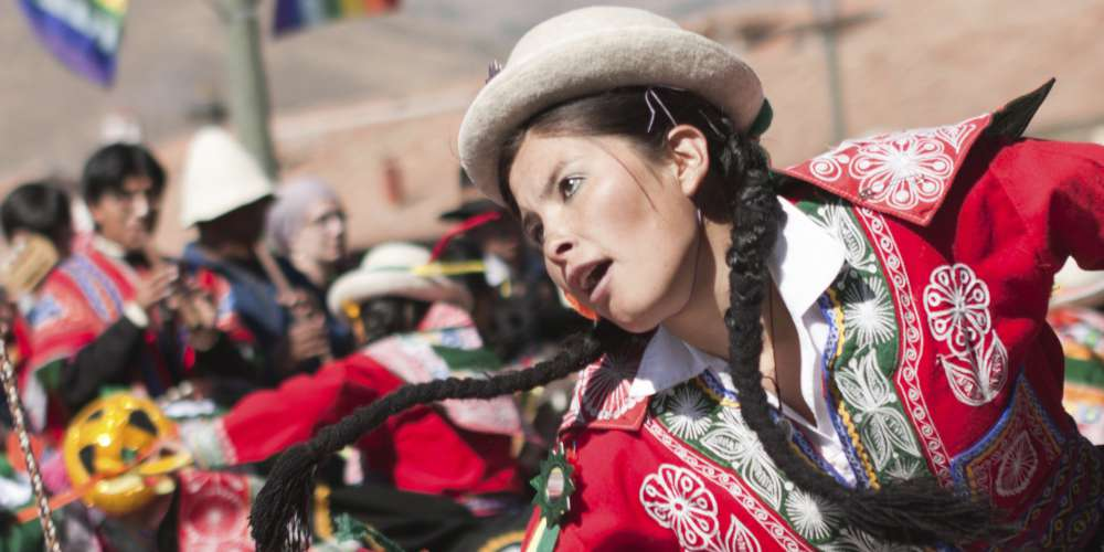 Young woman dancing during the Inti Raymi festival