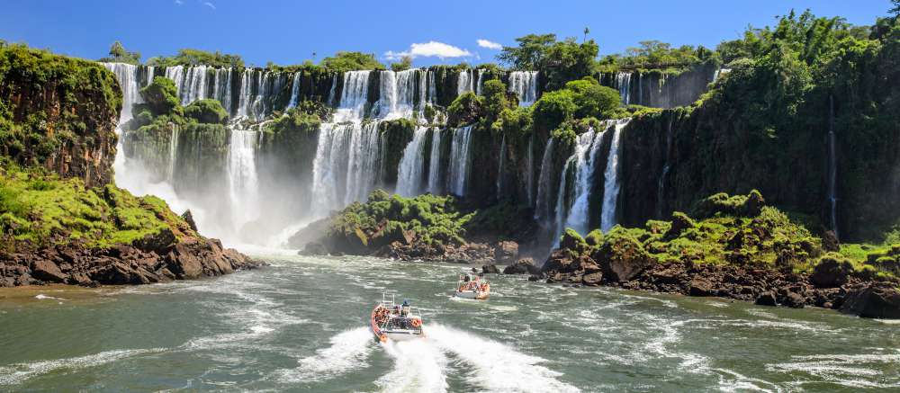Take a boat up to the Iguazú Falls