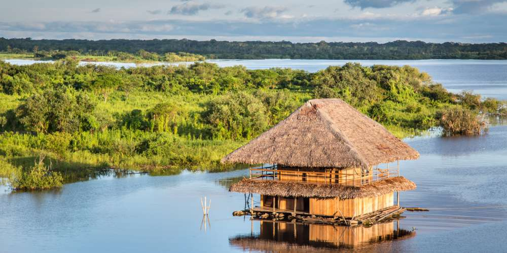 Traditional floating house on the Amazon River, Iquitos