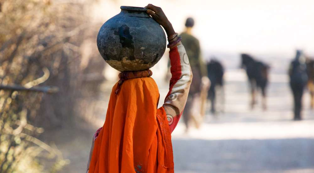 Woman carrying water, near Udaipur