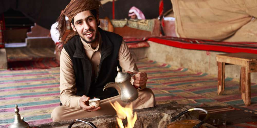 A bedouin making coffee