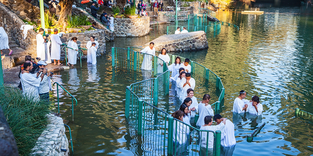 Christian pilgrims baptized in the Jordan River, Yardenit, Israel