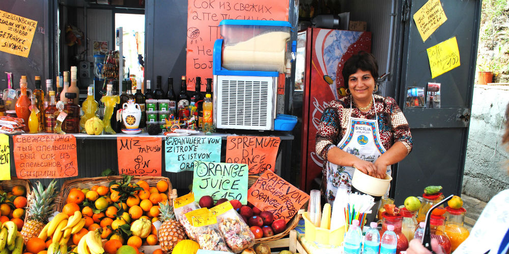 Fruit stall vendor, Palermo, Sicily, Italy