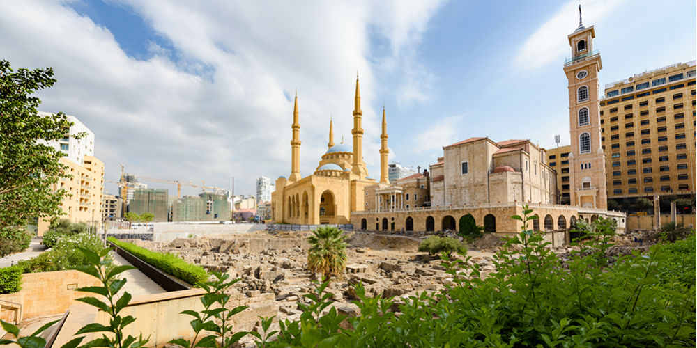 Saint George Maronite Cathedral and Mohammad Al Amine blue Mosque across roman ruins in downtown Beirut, Lebanon